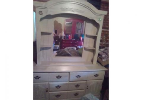 Triple dresser with mirror and chifferobe.
